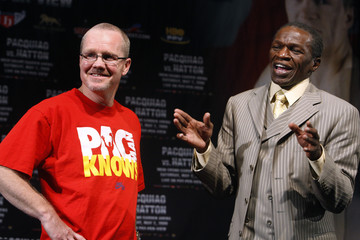 Freddie Roach listens to Floyd Mayweather Sr during a news conference at the MGM Grand Hotel and Casino in Las Vegas