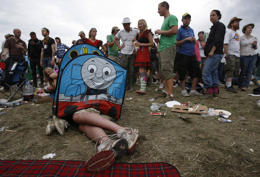 A couple sleep under a child's tent at the Glastonbury Festival 2009 in south west England