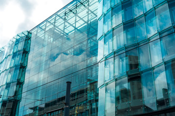 big glass office building in futuristic style