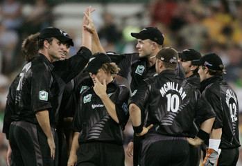 New Zealand cricketers celebrate the dismissal of Australia's Cameron White during a one day international cricket match in Sydney