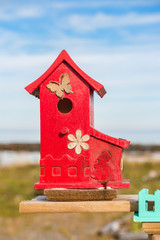 Close up of tiny and colorful wood house. Illustration for Real Estate or Construction.