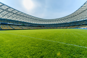 Panoramic view of soccer field stadium and stadium seats