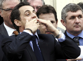 France's UMP political party presidential candidate Sarkozy blows a kiss to supporters as he campaigns in Saint-Didier