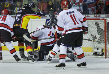 DAFFNER OF GERMANY SCORES AGAINST CANADA AT GERMAN ICE HOCKEY CUP INHANOVER.
