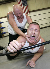 -PHOTO TAKEN 15JUN06- Billy Roberts (L) (also known as Billy V) applies a modified Camel Clutch to J..