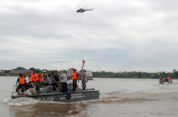 Cambodian police conduct a drill of flood victims rescue operation during the demonstration of ASEAN's disaster emergency exercise at Ta Khmau town of Kandal province