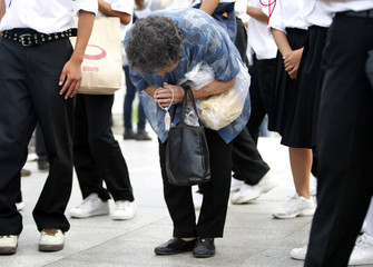 A woman prays for atomic bomb victims at the Peace Memorial Park in Hiroshima