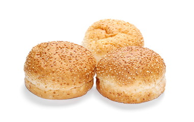 Three burger buns with sesame isolated on white background