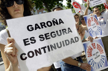 Workers of Garona nuclear power station take part in a protest against the plant's planned closure in Madrid