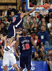 USA'S VINCE CARTER FLIES THROUGH THE AIR TO DUNK AGAINST FRANCE IN OLYMPICS.
