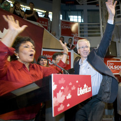 Liberal Leader Stephane Dion waves to supporters during campaign rally in Vancouver