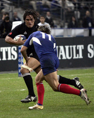 All Blacks So'oialo avoids a tackle by Heymans of France to score during their rugby test match at ...