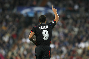 Olympique Lyon's John Carew celebrates his goal against Real Madrid during their Champions League Group E soccer match in Madrid