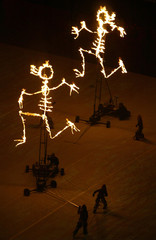BURNING HUMAN-LIKE FIGURES ARE PUSHED AROUND THE OLYMPIC STADIUM DURINGTHE REHEARSAL FOR THE ...