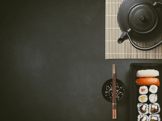 Sushi with a bowl, chopsticks and tea pot - Japanese fingerfood - Backround