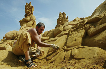 SAND CARVER ASSIIV OF RUSSIA IS SEEN SCULPTING DURING THE SANDSCULPTURES FESTIVAL IN BLANKENBERGE.