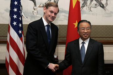 US Deputy Secretary of State Robert B. Zoellick shakes hands with Chinese Deputy Foreign Minister Dai ...