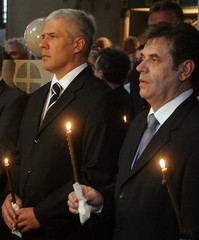 Serbian President Tadic and Prime Minister Kostunica hold candles during memorial service at St ...