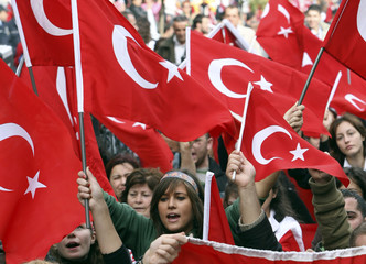 Protesters wave Turkish flags as they march through Istanbul