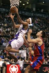 Raptors Rose grabs a rebound in front of Clippers Rebraca.