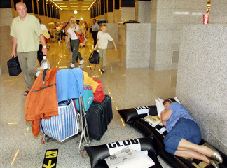 A BRITISH TOURIST REST IN MAJORCA'S AIRPORT DUE TO COACH DRIVERS STRIKE.