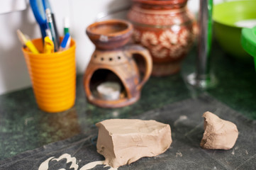 Raw clay lies on the table
