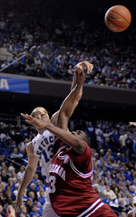 University of Kentucky's Bobby Perry blocks the shot of Indiana University's D.J. White in Lexington