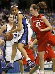 Duke University's Lindsey Harding battle Rutgers University's Heather Zurich for a rebound in Greensboro