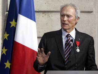 Veteran US actor and director Clint Eastwood speaks after receiving Legion of Honor medal in Paris