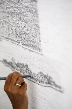British artist Stephen Wiltshire works on a hand drawn panorama of the skyline of New York, from a studio in Brooklyn at the Pratt Institute