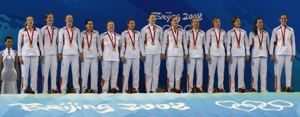 Netherlands players stand with their gold medals on the podium after their women's water polo gold medal match against the U.S. at the Beijing 2008 Olympic Games