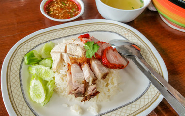Thai gourmet steamed  Hainanese chicken , Crispy pork and Barbecued pork with rice .