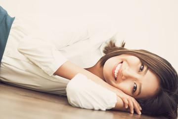 Cheerful Asian businesswoman resting on floor