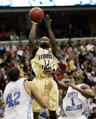 North Carolina's Scott and May against Georgia Tech's Bynum during ACC semifinal game.