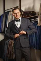 Portrait of serious fashionable handsome man in blue suit, Sexy man standing and looking at the camera