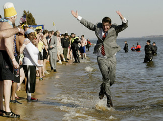 People participate in the Polar Bear Plunge outside Annapolis
