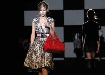 A model presents a creation from the Spring 2008 L.A.M.B. collection during New York Fashion Week