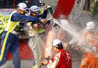Mikko Hirvonen of Finland and his compatriot co-driver Jarmo Lehtinen celebrate winning the Rally Japan in Obihiro, Japan