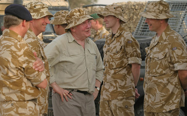 New British Defense Minister meets troops in southern Iraq city of Basra.