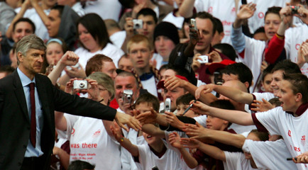 Arsenal manager Wenger greets supporters during a lap of honour around Highbury