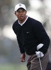 U.S. golfer Tiger Woods watches his drive while practicing on the north course at Torrey Pines in San Diego as he prepares for his first tournament of the season