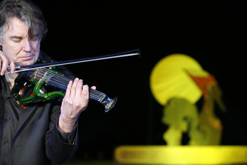 Didier Lockwood, the composer for 'The Princess of the Sun', an animated French-Belgium cartoon about Tutankhamun's reign plays the violin before the world premiere of the film held at the pyramids in Giza