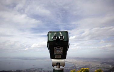 Binoculars face the city of Cape Town on top of Table Mountain