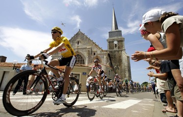 Spectators cheer for CSC rider Zabriskie of U.S. during second stage of Tour de France cycling race.