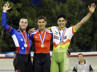WINNER CYCLISTS OF MEN'S 1KM TIME TRIAL ON THE PODIUM.