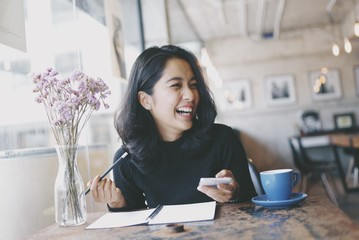 Asian woman in coffee shop cafe