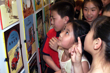 Chinese children look at the Chinese version of the popular Belgian cartoon series books, the Advent..