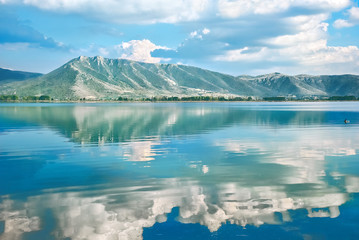 Landscape with a lake Orestiada, reflection of clouds in water