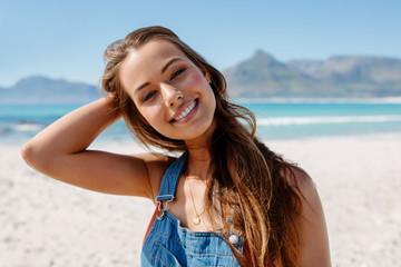 Beautiful young caucasian female model on the seashore.