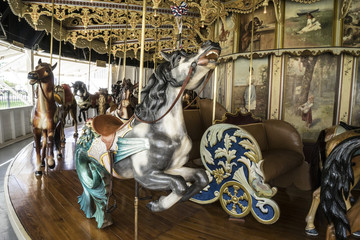Vintage restored carousel hand carved wooden seahorse on a merry go round ride